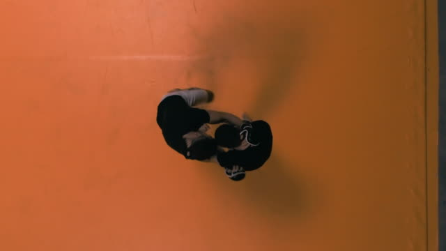 mma ground fight training. throwing partner onto the mat. aerial view - combat sport stock videos & royalty-free footage
