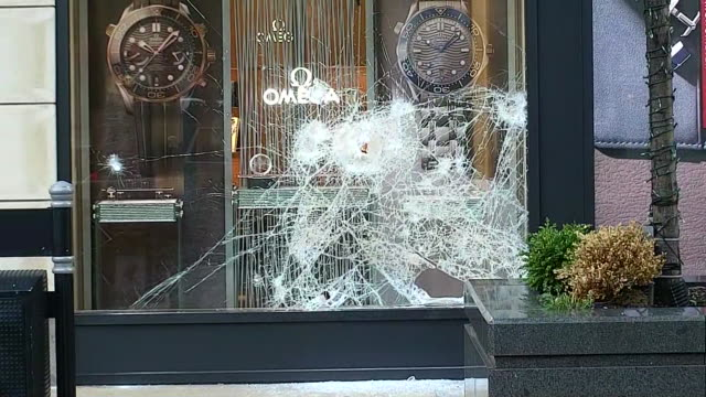 ground level establishing shot of looting damage and aftermath at an omega luxury store in chicago. - crime or recreational drug or prison or legal trial stock videos & royalty-free footage