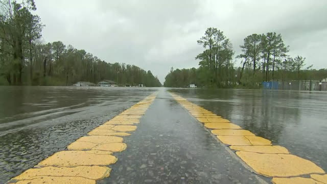 ground level shot of a flooded roadway after hurricane florence on september 16, 2018 in wilmington, north carolina. - wilmington north carolina stock videos & royalty-free footage