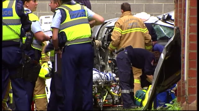 ground level shots of scene - police and rescue workers at car fall accident scene / car park looking up pov ground level - see missing railing and... - traffic accident stock videos & royalty-free footage