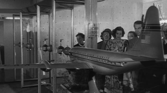 1950 montage ground operations at the airport, including booking agents / united kingdom - fahrkarte oder eintrittskarte stock-videos und b-roll-filmmaterial