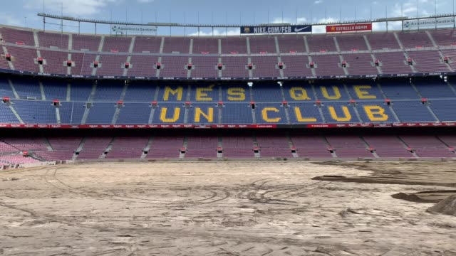 ground staff replace the pitch of the fc barcelona camp nou stadium ahead of la liga 20192020 season on july 09 2019 in barcelona spain - pitch stock videos & royalty-free footage