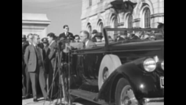 ms ground view president franklin d roosevelt sitting in car outside the rhode island state house secret service stand on far side of car police and... - head back stock videos & royalty-free footage