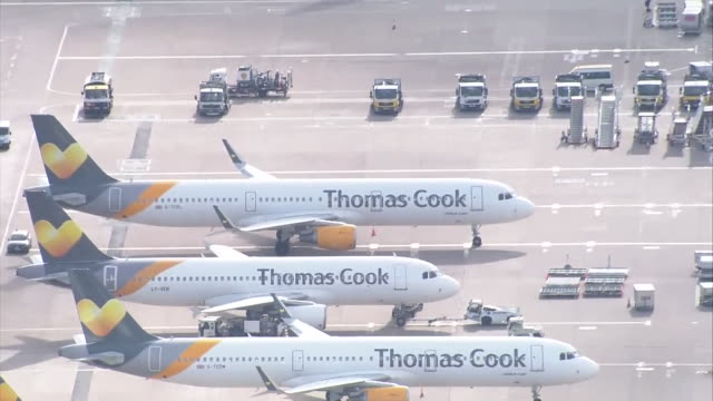 grounded thomas cook planes at manchester airport as the travel company goes into administration - aeroplane stock videos & royalty-free footage