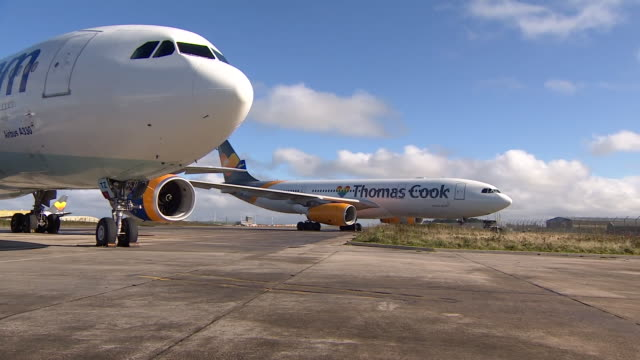 grounded thomas cook planes in cornwall - aeroplane stock videos & royalty-free footage