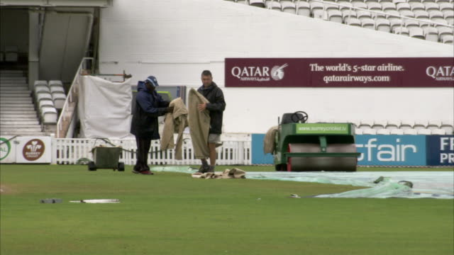 groundskeepers work on the field at the oval cricket ground. available in hd. - ground staff stock videos & royalty-free footage