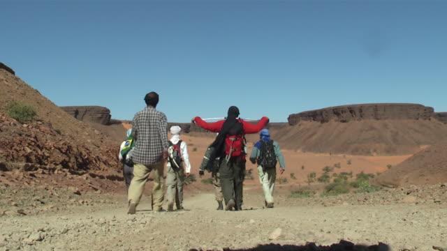 ws group and nomad crossing desert / atar, adrar, mauritania - mauritania stock videos & royalty-free footage