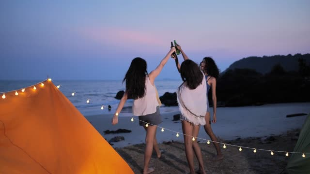 group beautiful women having fun together drinking beer and camping,summer holidays and vacation concept.camping - outdoor pursuit stock videos & royalty-free footage