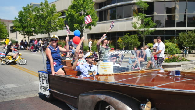 """group calling themselves the grassroots goofballs marches with signs reading, """"get out the boat,"""" with some members riding in an amphibian boat car,... - satire stock-videos und b-roll-filmmaterial"""