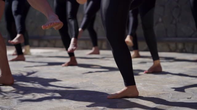 group dancing barefoot outdoors - trainer stock videos & royalty-free footage