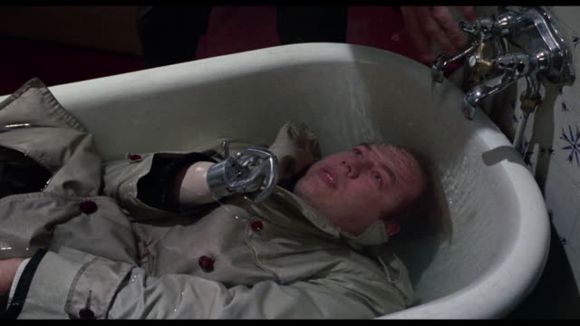1963 Group discovers dead body in a bathtub