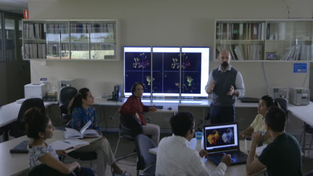 group discussion in science technology classroom with mature students - medical research stock videos & royalty-free footage