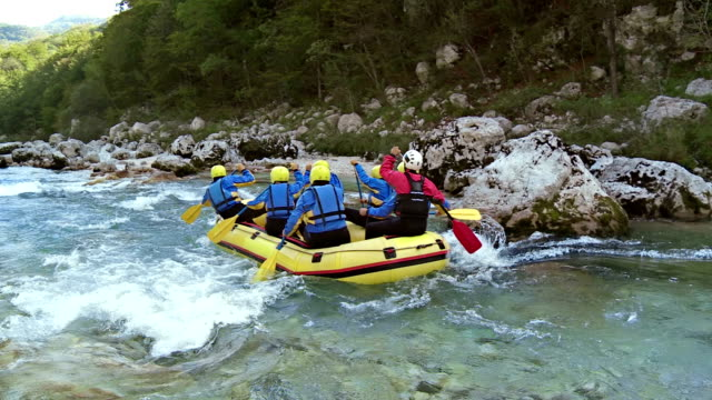 hd: group enjoying white water rafting - inflatable raft stock videos and b-roll footage