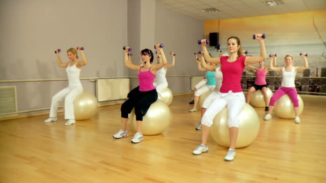 hd crane: group exercise - fitness ball stock videos & royalty-free footage