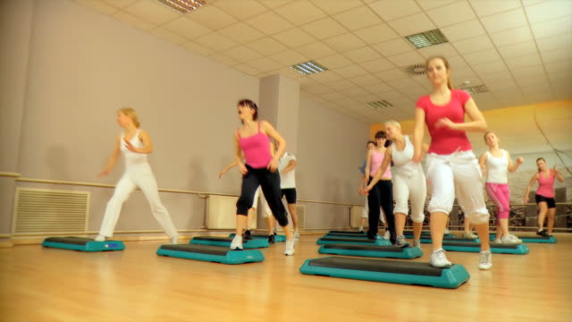 hd crane: group exercise - step aerobics stock videos and b-roll footage