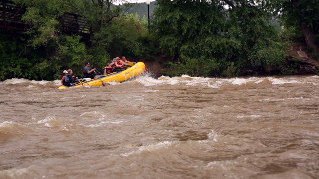 group going down river in yellow raft - rafting stock videos and b-roll footage