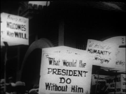 pan group holding signs supporting will rogers as mayor of beverly hills / newsreel - 1926 stock videos & royalty-free footage
