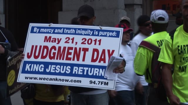 Group holds signs announcing May 21 2011 Judgment Day at Education Rally / United Federation of Teachers' rally and march against education budget...
