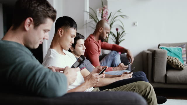 group male friends all on smartphones - disrespect stock videos & royalty-free footage