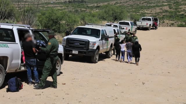 a group of 30 central americans consisting of family units and unaccompanied children enter the united states west of sasabe arizona and surrender to... - undocumented immigrant stock videos & royalty-free footage