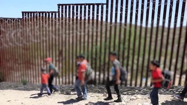 group of 30 central americans consisting of family units and unaccompanied children enter the united states west of sasabe, arizona and surrender to... - frame border stock videos & royalty-free footage