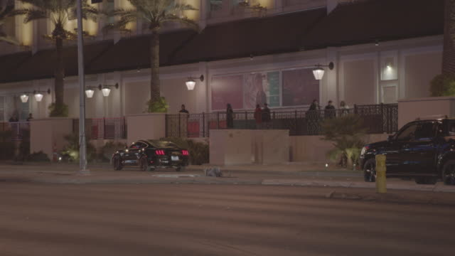 group of 5 police cars r-b, lights on, las vegas strip; 3 - pull into bally's exit driveway - night - bally's las vegas stock videos & royalty-free footage