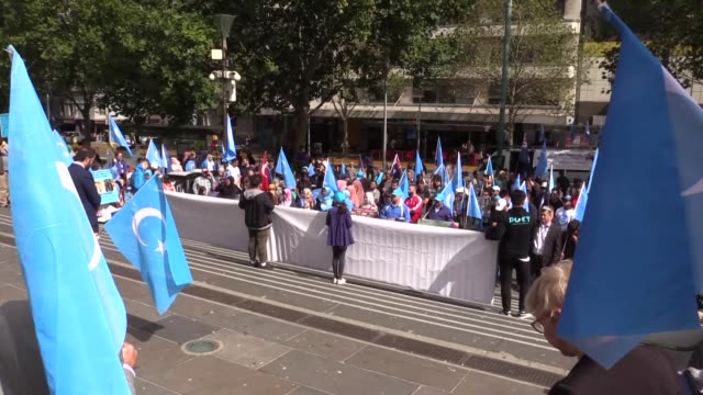 a group of activists gather outside the chinese consulategeneral in melbourne to protest china's human rights violations against turkic uyghur... - china east asia stock videos & royalty-free footage