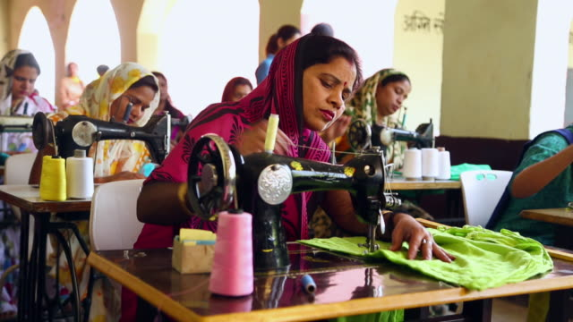 Group of adult women sewing clothes, Sonipat, Haryana, India