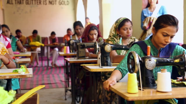 group of adult women sewing clothes, sonipat, haryana, india - indian politics stock videos & royalty-free footage