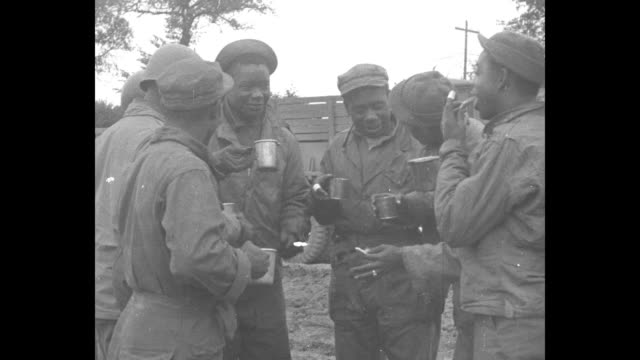"group of african-american soldiers, members of the ""red ball express"" us army convoy of trucks to deliver supplies in wwii europe, stand around... - world war ii video stock e b–roll"