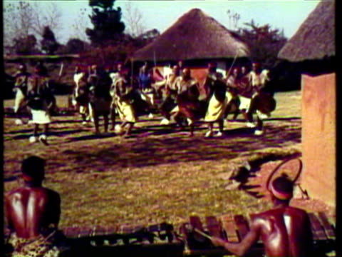 1953 WS MS Group of Africans perform tribal dance while others play percussion / Johannesburg, South Africa / AUDIO