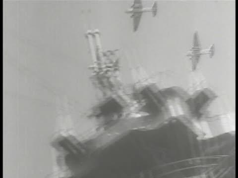 Group of aircraft in flight over warship HA WS Japanese warships on ocean Warship ship's wake