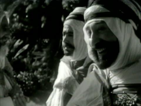 group of algerian sheikh chieftains talking on street. sheikh talking. embracing, meeting. elder, tribe lord, wise man, scholar, north africa - シャイフ点の映像素材/bロール