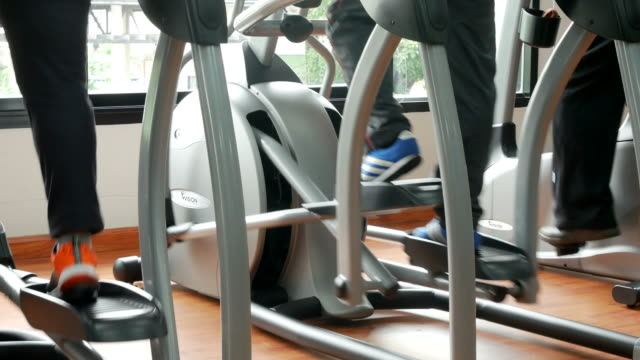 group of anonymous people using running machines - sports hall stock videos & royalty-free footage