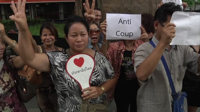 group of anti-coup protesters demonstrate on thamalsat university campus in bangkok thailand on june 1, 2014. - coup d'état stock videos & royalty-free footage