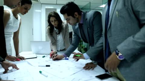 group of architects doing meeting in the office, delhi, india - indien bildbanksvideor och videomaterial från bakom kulisserna