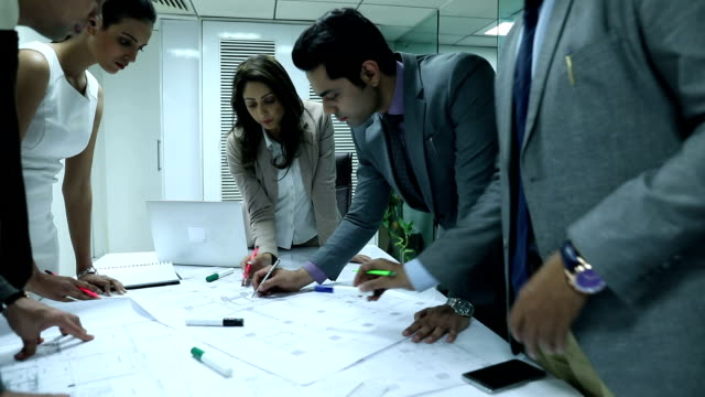 stockvideo's en b-roll-footage met group of architects doing meeting in the office, delhi, india - indisch subcontinent etniciteit