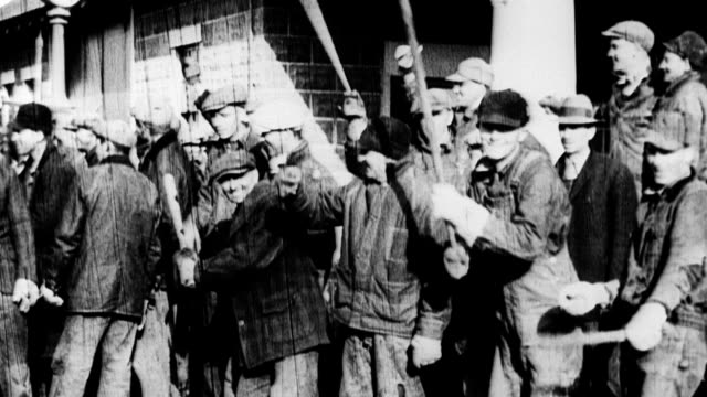 group of armed iowa farmers in the back of a pick up truck / cars drive through crowds armed with sticks and guns / several farmers jump onto the... - 1933 stock videos and b-roll footage