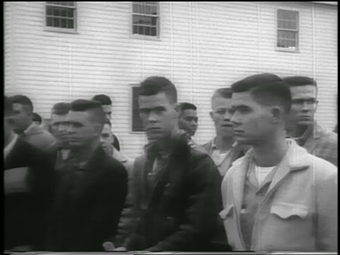 stockvideo's en b-roll-footage met pan group of army recruits on base / elvis presley in group / fort chaffee arkansas - army