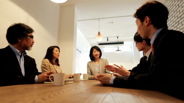 group of asian business people having a meeting - only japanese stock videos & royalty-free footage