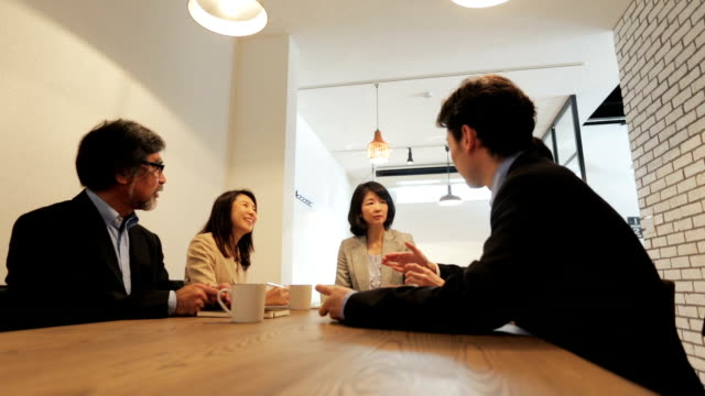 group of asian business people having a meeting - staff meeting stock videos & royalty-free footage