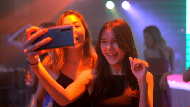 group of asian dancing friends enjoying night party - concert stock videos & royalty-free footage