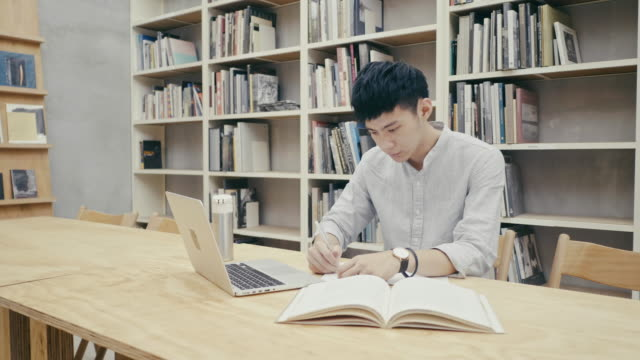 group of asian students studying in the library - taipei stock videos & royalty-free footage