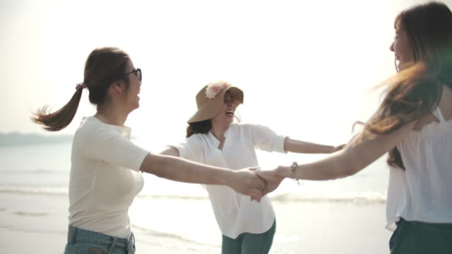 group of asian woman friend have fun on beach - oahu stock videos & royalty-free footage
