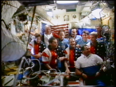 group of astronauts and cosmonauts smiling posing in mir space station / sts86 - mir space station stock-videos und b-roll-filmmaterial