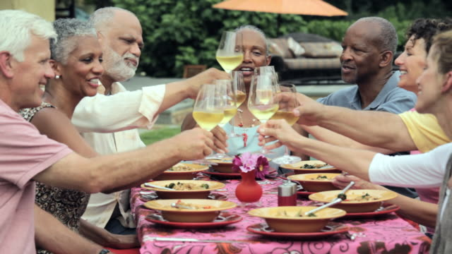 ms, pan, group of baby boomer couples eating together outside, toasting with wine, richmond, virginia, usa - italian food stock videos and b-roll footage