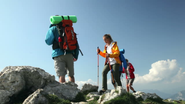 Group of Backpacker reaching the top