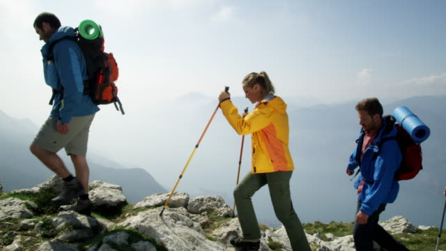 group of backpacker reaching the top - four people stock videos & royalty-free footage