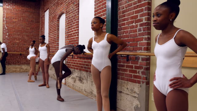 ms group of ballet dancers resting during practice in ballet studio - tights stock videos and b-roll footage