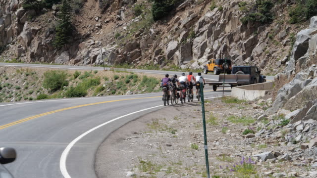 group of bike cyclists on colorado 550 highway in america amid the 2020 global coronavirus pandemic - mountain bike stock videos & royalty-free footage